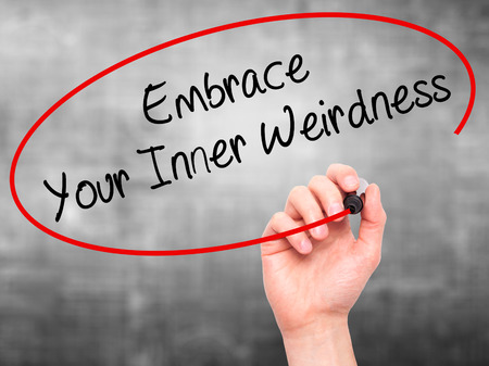 street wise: Man Hand writing Embrace Your Inner Weirdness  with black marker on visual screen. Isolated on grey. Business, technology, internet concept. Stock Photo Stock Photo