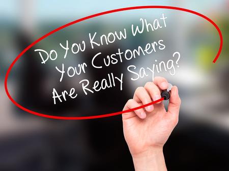 男手書きかあなたはあなたの顧客が本当に何を言ってを知っていますか。ビジュアル画面で黒マーカー。背景に分離されました。ビジネス、技術、 写真素材