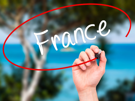 champagne region: Man Hand writing France with black marker on visual screen. Isolated on nature. Business, technology, internet concept. Stock Photo