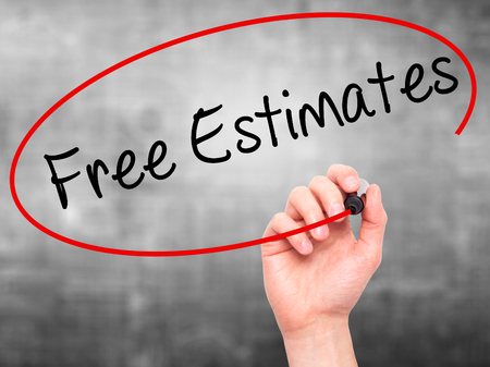 estimates: Man Hand writing Free Estimates with black marker on visual screen. Isolated on grey. Business, technology, internet concept. Stock Photo