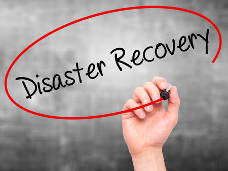 Man Hand writing Disaster Recovery with black marker on visual screen. Isolated on background. Business, technology, internet concept. Stock Photo Archivio Fotografico