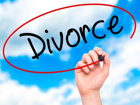 ex wife: Man Hand writing Divorce  with black marker on visual screen. Isolated on sky. Business, technology, internet concept. Stock Photo Stock Photo