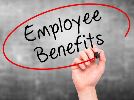 employee: Man Hand writing Employee Benefits with black marker on visual screen. Isolated on grey. Business, technology, internet concept. Stock Photo