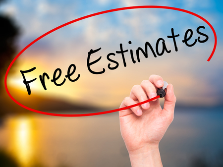 estimates: Man Hand writing Free Estimates with black marker on visual screen. Isolated on nature. Business, technology, internet concept. Stock Photo
