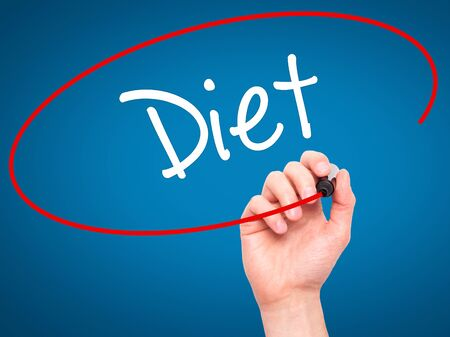 nutricion: Man Hand writing Diet (in Portuguese)  with black marker on visual screen. Isolated on blue. Business, technology, internet concept. Stock Photo