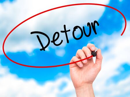redirect: Man Hand writing Detour  with black marker on visual screen. Isolated on sky. Business,  internet concept. Stock Photo