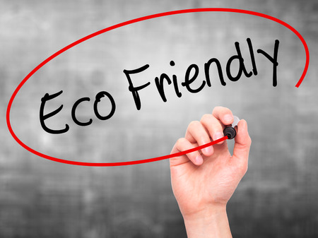 e waste: Man Hand writing Eco Friendly with black marker on visual screen. Isolated on background. Business, technology, internet concept. Stock Photo