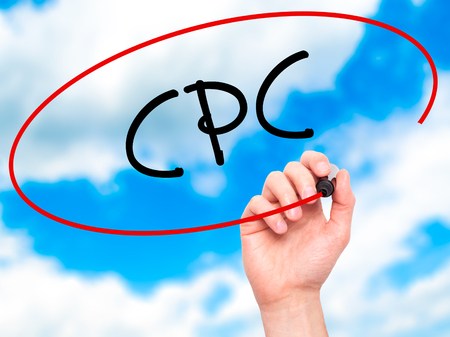 cpc: Man Hand writing CPC (Cost Per Click)  with black marker on visual screen. Isolated on background. Business, technology, internet concept. Stock Photo