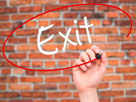 divorcing: Man Hand writing Exit with black marker on visual screen. Isolated on background. Business, technology, internet concept. Stock Photo