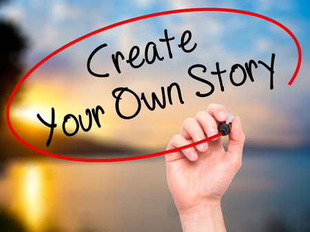 Man Hand writing Create Your Own Story with black marker on visual screen. Isolated on background. Business, technology, internet concept. Stock Photo Stock Photo