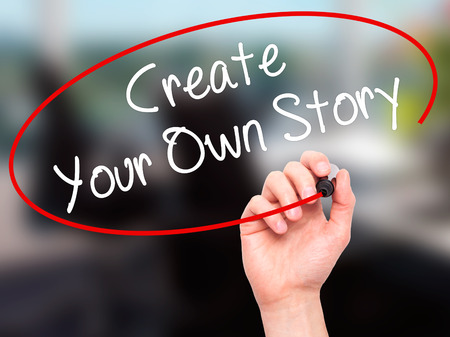 photo story: Man Hand writing Create Your Own Story with black marker on visual screen. Isolated on background. Business, technology, internet concept. Stock Photo Stock Photo