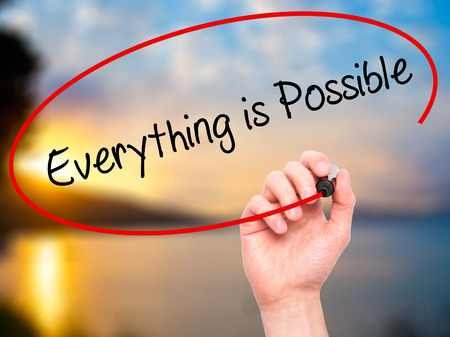 positivism: Man Hand writing Everything is Possible with black marker on visual screen. Isolated on nature. Business, technology, internet concept. Stock Photo Stock Photo