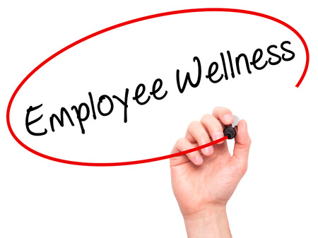 Man Hand writing Employee Wellness with black marker on visual screen. Isolated on background. Business, technology, internet concept. Stock Photo Standard-Bild