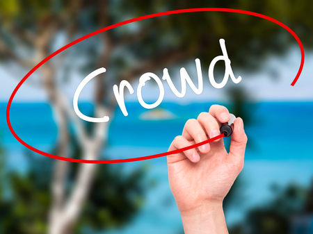 differentiation: Man Hand writing Crowd with black marker on visual screen. Isolated on nature. Business, technology, internet concept. Stock Photo Stock Photo
