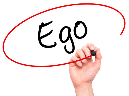 egoista: Man Hand writing Ego with black marker on visual screen. Isolated on background. Business, technology, internet concept. Stock Photo