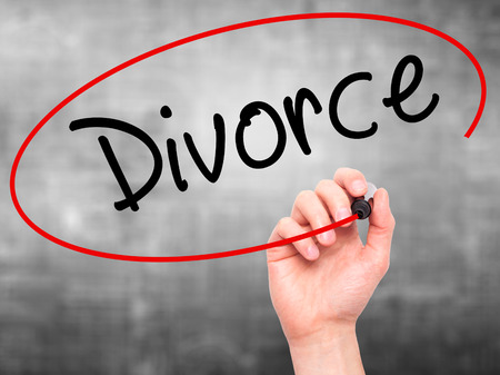 ex wife: Man Hand writing Divorce  with black marker on visual screen. Isolated on grey. Business, technology, internet concept. Stock Photo