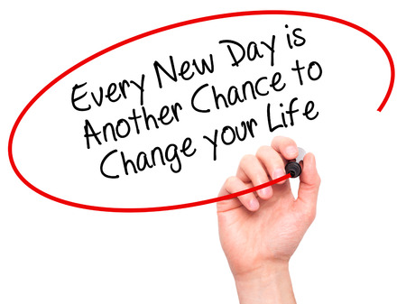 Man Hand writing Every New Day is Another Chance to Change your Life with black marker on visual screen. Isolated on white. Business, technology, internet concept. Stock Photo
