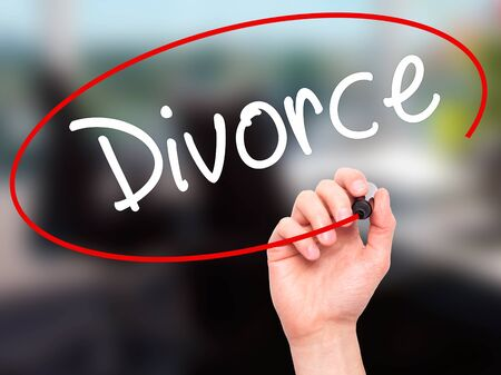 ex husband: Man Hand writing Divorce  with black marker on visual screen. Isolated on office. Business, technology, internet concept. Stock Photo Stock Photo