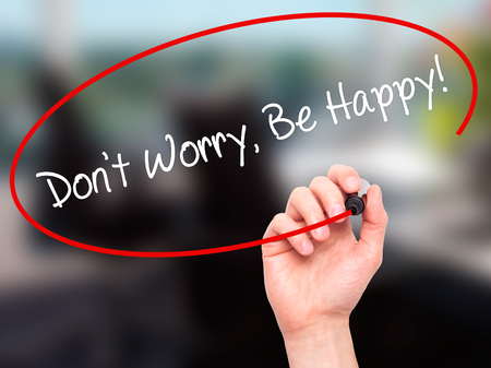 dont worry: Man Hand writing Dont Worry, Be Happy! with black marker on visual screen. Isolated on office. Business, technology, internet concept. Stock Photo