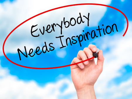 everybody: Man Hand writing Everybody Needs Inspiration with black marker on visual screen. Isolated on background. Business, technology, internet concept. Stock Photo
