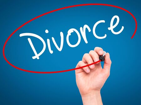 ex wife: Man Hand writing Divorce  with black marker on visual screen. Isolated on blue. Business, technology, internet concept. Stock Photo Stock Photo