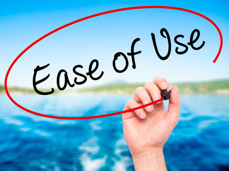 with ease: Man Hand writing Ease of Use with black marker on visual screen. Isolated on nature. Business, technology, internet concept. Stock Photo