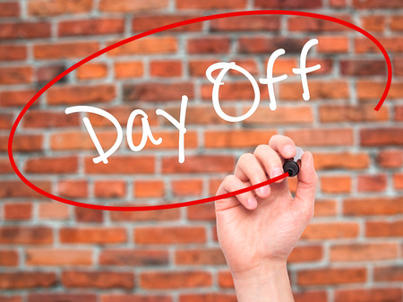 Man Hand writing Day Off  with black marker on visual screen. Isolated on background. Business, technology, internet concept. Stock Photo