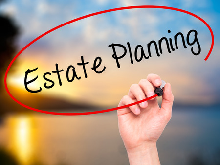 contingent: Man Hand writing Estate Planning with black marker on visual screen. Isolated on nature. Business, technology, internet concept. Stock Photo