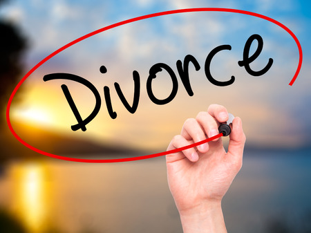 ex husband: Man Hand writing Divorce  with black marker on visual screen. Isolated on nature. Business, technology, internet concept. Stock Photo