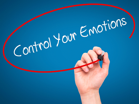 Man Hand writing Control Your Emotions with black marker on visual screen. Isolated on blue. Business, technology, internet concept. Stock Photo