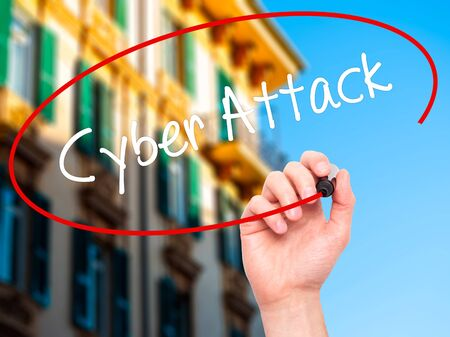 internet attack: Man Hand writing Cyber Attack with black marker on visual screen. Isolated on city. Business, technology, internet concept. Stock Photo Stock Photo