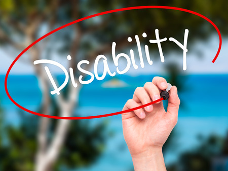 helplessness: Man Hand writing Disability with black marker on visual screen. Isolated on nature. Business, technology, internet concept. Stock Photo