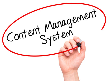 ecm: Man Hand writing Content Management System  with black marker on visual screen. Isolated on white. Business, technology, internet concept. Stock Photo
