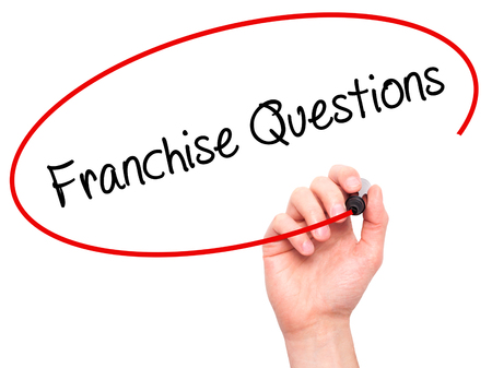 franchising: Man Hand writing Franchise Questions with black marker on visual screen. Isolated on white. Business, technology, internet concept. Stock Photo