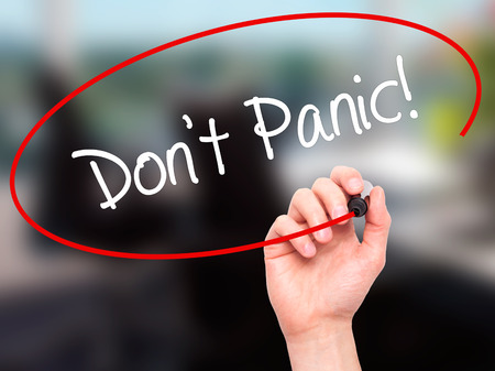 don't care: Man Hand writing Dont Panic! with black marker on visual screen. Isolated on background. Business, technology, internet concept. Stock Photo