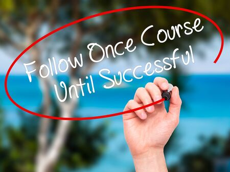 executive courses: Man Hand writing Follow Once Course Until Successful with black marker on visual screen. Isolated on nature. Business, technology, internet concept. Stock Photo