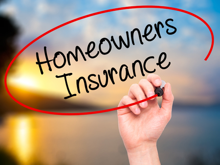 homeowners insurance: Man Hand writing Homeowners Insurance with black marker on visual screen. Isolated on background. Business, technology, internet concept. Stock Photo