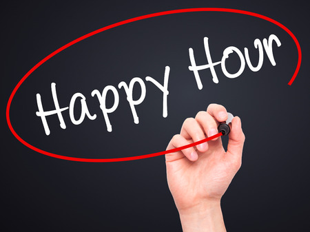 happyhour: Man Hand writing Happy Hour with black marker on visual screen. Isolated on black. Business, technology, internet concept. Stock Image Stock Photo