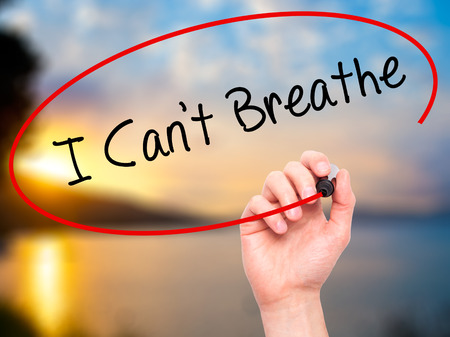 cant: Man Hand writing I Cant Breathe  with black marker on visual screen. Isolated on nature. Business, technology, internet concept. Stock Photo