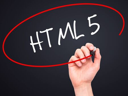 html 5: Man Hand writing HTML 5 with black marker on visual screen. Isolated on black. Business, technology, internet concept. Stock Photo