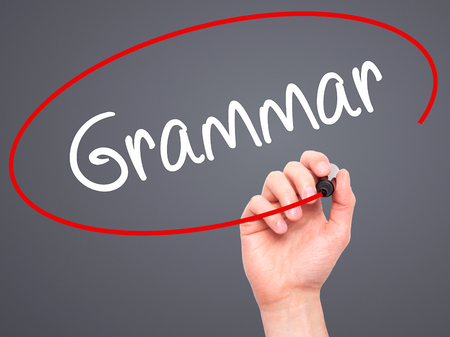 adjective: Man Hand writing Grammar with black marker on visual screen. Isolated on background. Business, technology, internet concept. Stock Photo Stock Photo