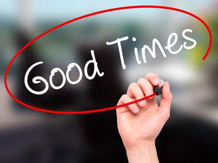 good times: Man Hand writing Good Times with black marker on visual screen. Isolated on background. Business, technology, internet concept. Stock Photo