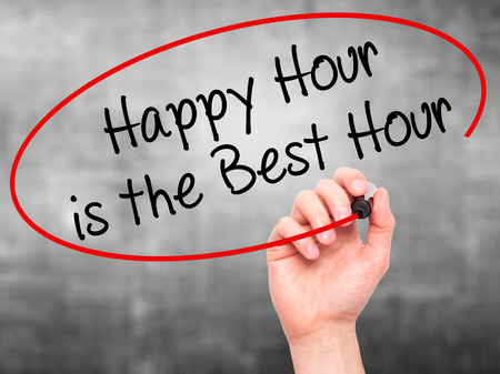 working hour: Man Hand writing Happy Hour is the Best Hour  with black marker on visual screen. Isolated on grey. Business, technology, internet concept. Stock Photo