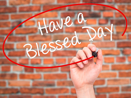 think through: Man Hand writing Have a Blessed Day  with black marker on visual screen. Isolated on background. Business, technology, internet concept. Stock Photo Stock Photo