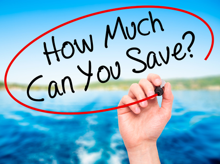 Man Hand writing How Much Can You Save? with black marker on visual screen. Isolated on nature. Business, technology, internet concept. Stock Photo