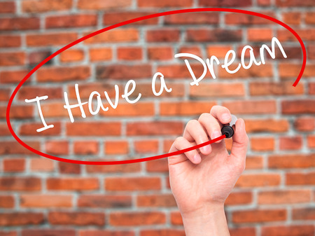visions of america: Man Hand writing I Have a Dream with black marker on visual screen. Isolated on bricks. Business, technology, internet concept. Stock Photo Stock Photo