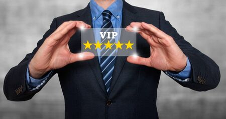 five star: Businessman holding five star rating VIP - Grey - Stock Image Stock Photo