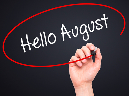 hi back: Man Hand writing Hello August with black marker on visual screen. Isolated on black. Business, technology, internet concept. Stock Photo Stock Photo