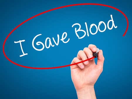 blood plasma: Man Hand writing I Gave Blood with black marker on visual screen. Isolated on background. Business, technology, internet concept. Stock Photo Stock Photo