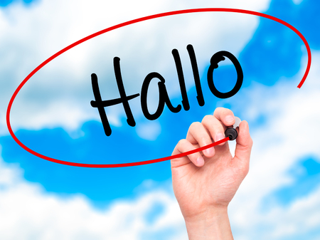 hallo: Man Hand writing Hallo  (Hello in German) with black marker on visual screen. Isolated on background. Business, technology, internet concept. Stock Photo